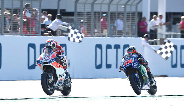 the chequered flag drops on the 2017 Silverstone MotoGP race