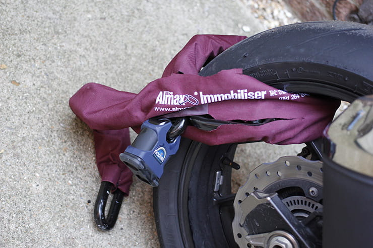 A Motorcycle Chain wrapper around a motorcycle wheel