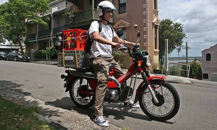 Nathan Millward on an Australian Post Office motorcycle