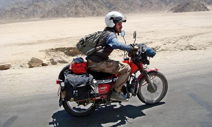 Nathan Millward rides his motorcycle back from Australia to the UK