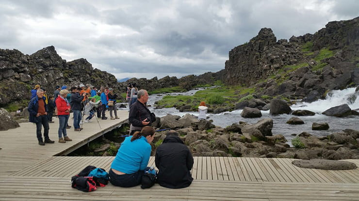 people sat around a hot pool in Iceland