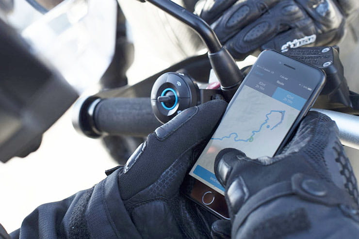 A rider using the NuViz system logs into the app on their phone