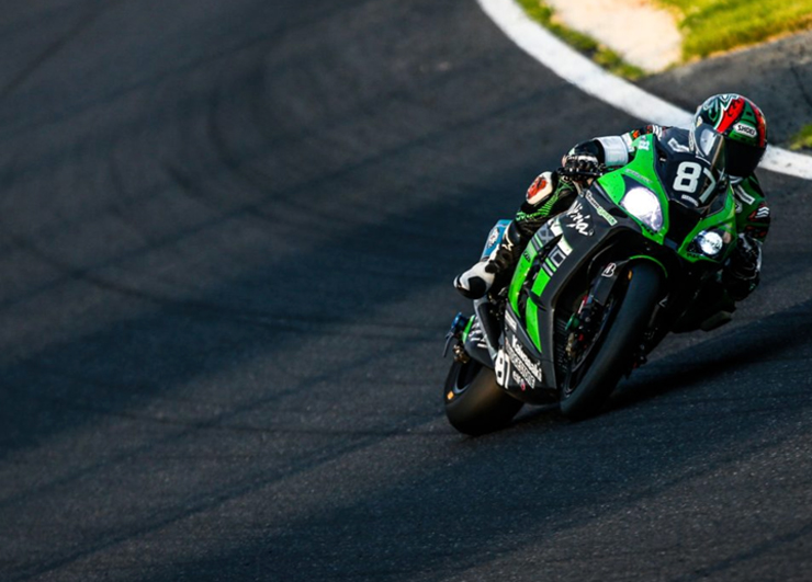 A Kawasaki races at dusk in the Suzuka 8 hour endurance race
