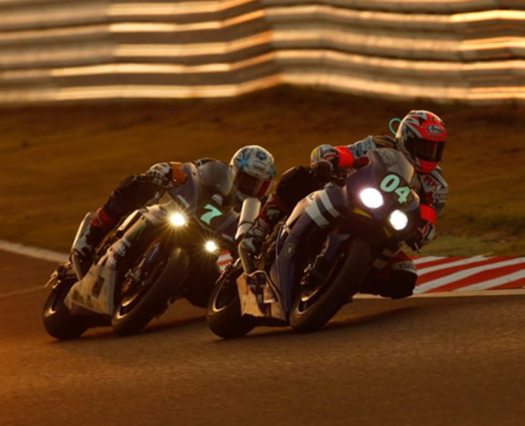 Yamaha R1M and Honda Fireblade race at dusk in the Suzuka 8 hour endurance race