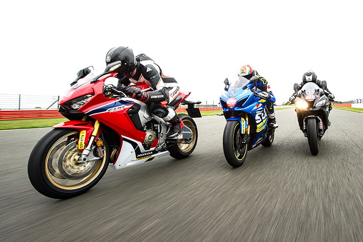 Three Superbikes ride on track in formation