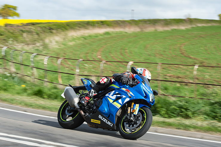 Suzuki GSXR1000RR goes quickly along a country road