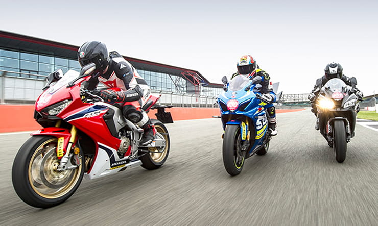 Three Superbikes race on track in close formation