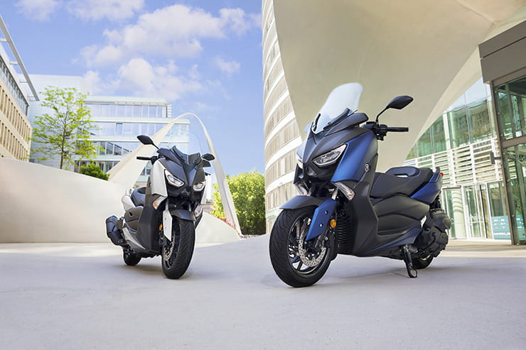 Two 2017 Yamaha X Max 400s outside a building