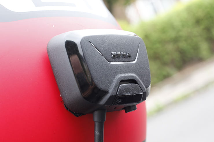 The Zona rear view camera receiver mounted on a crash helmet