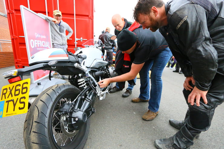 The BMW 2017 R NineT Racer gets inspected by the crowds at the Manx GP