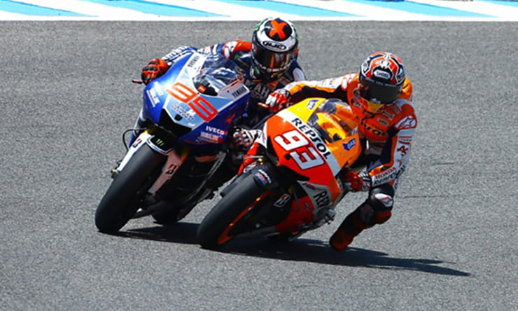 Why do MotoGP riders dangle a leg
