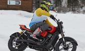 Racing a Harley Davidson 750 Street Rod on Ice and Snow at Ice Rosa Ring in Italy