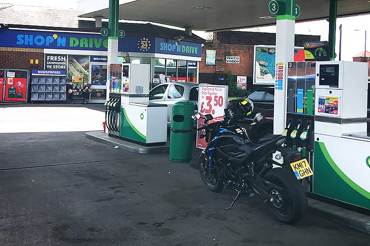 Why do some petrol stations make you take your helmet off?