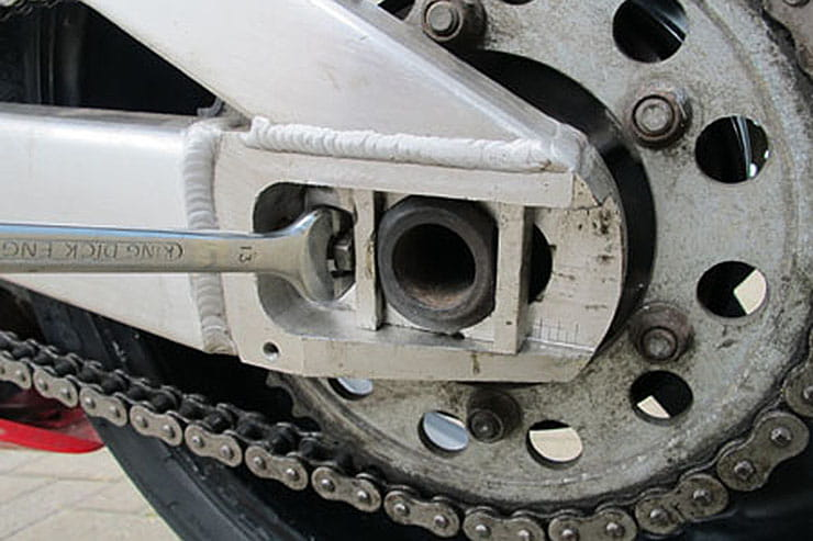How to properly adjust and tighten your motorcycle chain