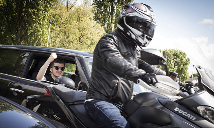 Getting tailgated while riding is annoying and risky, but here's what to do when you glance in your mirrors and see a car just feet from your numberplate.