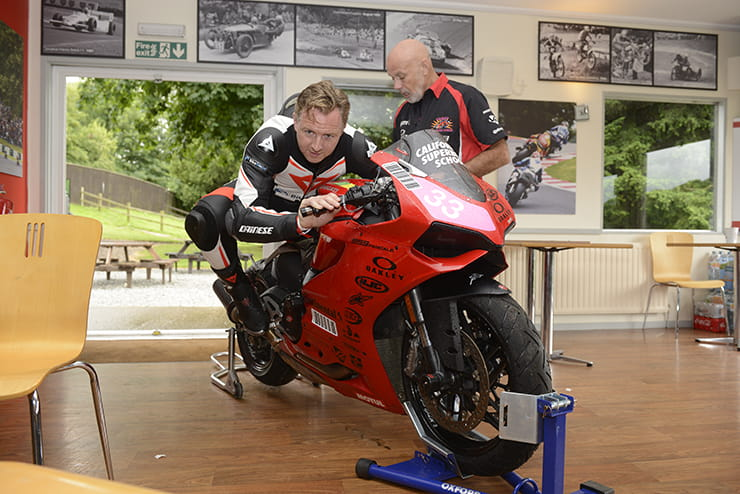 Mann learns knee-to-knee drill on a stationary 959 Panigale
