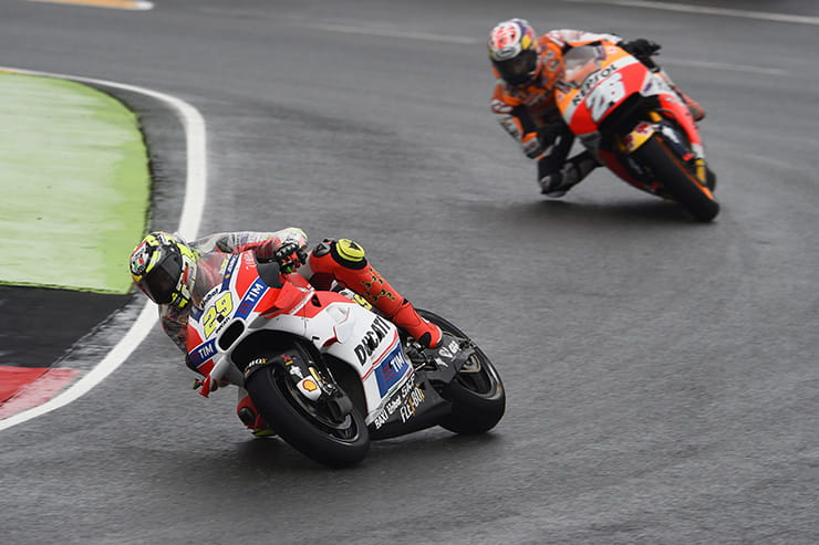 Andrea Iannone leads Dani Pedrosa at Sachsenring last time out