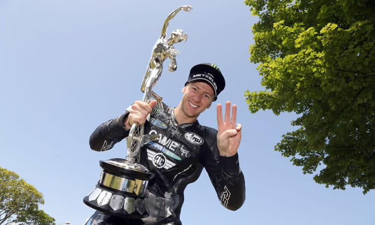 Ian hutchinson enjoys the spoils of another win in the supersport class at the Isle of man TT races