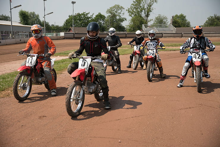 The group take to the track together to ride flat track