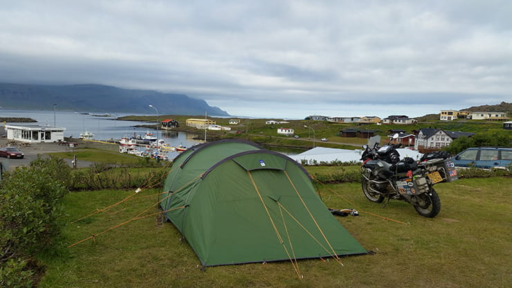 motorbike next to a tent at a campsite on a motorcycle touring trip
