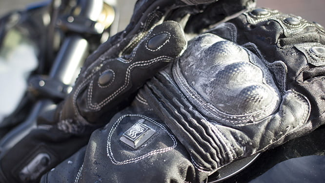 Warm black gloves for winter motorcycling