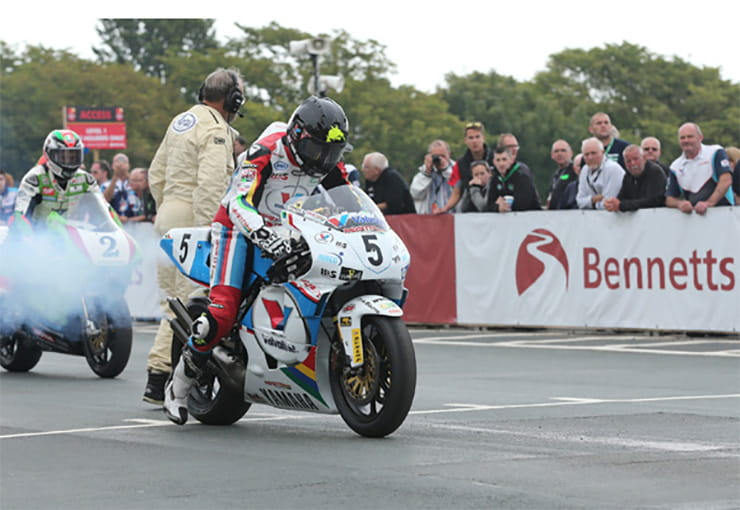 Bruce Anstey gets the smokey Yamaha away