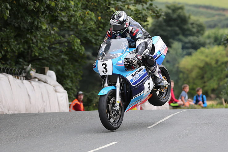 Michael Dunlop flies over Ballaugh Bridge on the Suzuki