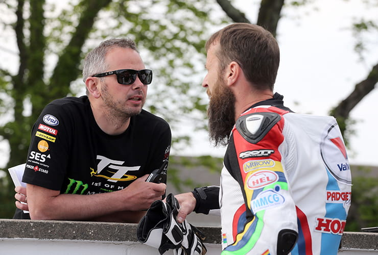 TT boss Paul Phillips chats with TT hero Bruce Anstey
