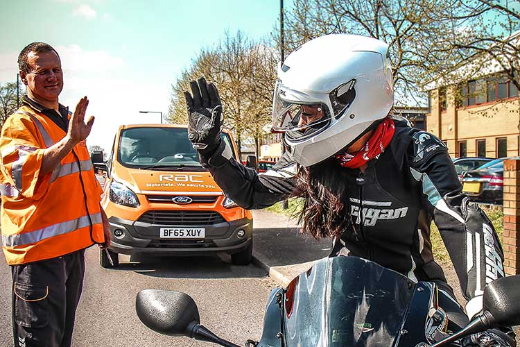 Lady on a motorbike with the RAC