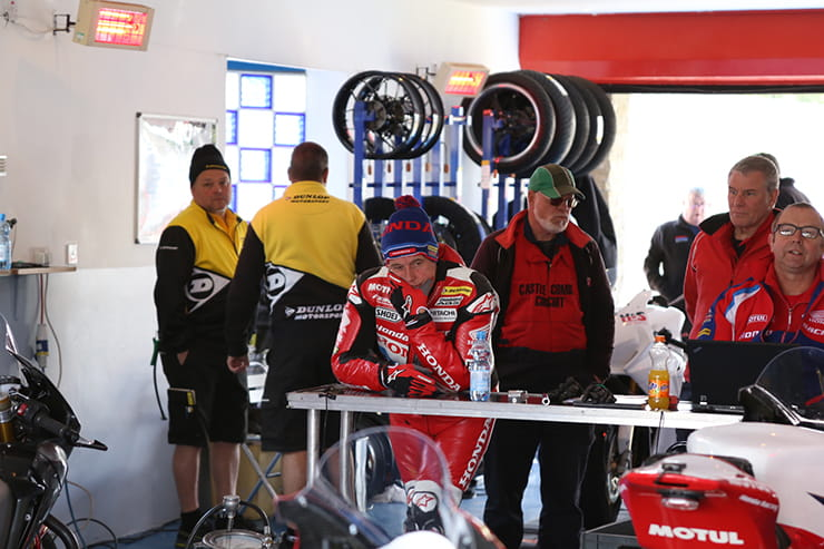 John McGuinness contemplates in the pit garage