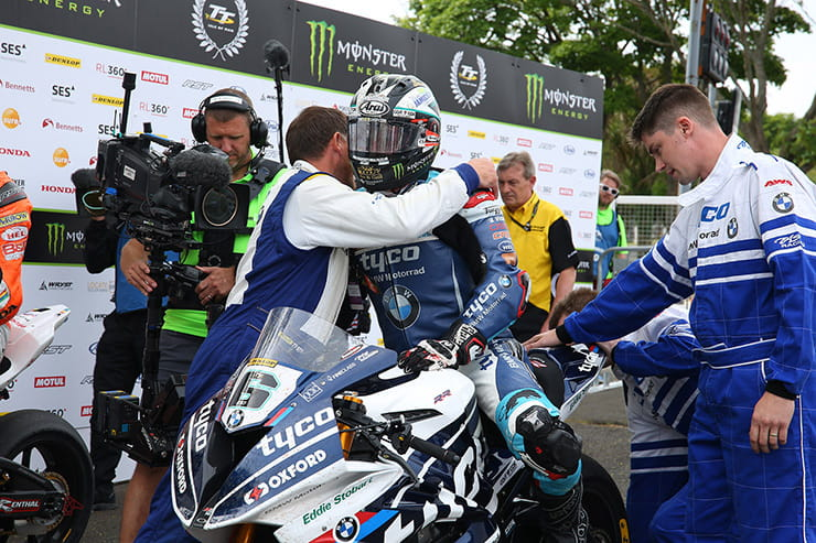 Michael Dunlop is congratulated by his Tyco BMW team