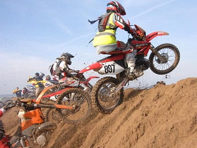 One lucky Honda rider makes it through the carnage at Weston