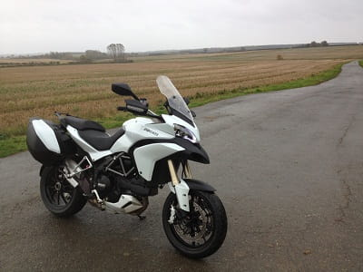 Multistrada sits on a wet backroad