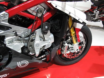 Belt-drive mechanical supercharger lurks beneath the fairing