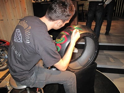 Pirelli tattoo tyres on their stand at the Milan Show