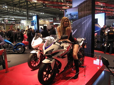 Honda's CBR500R, and a pretty girl. Race bike is in the background