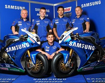 Honda Racing Bosses Neil Tuxworth (left) with Alex Lowes, Ryuichi Kiyonari, Havier Beltram and Jason O' Halloran