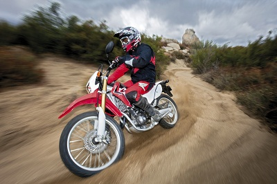 Sand, mud, forests. A bike like this will take you anywhere. Learn to ride one with Honda