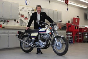 Eddie Lawson and the zero mile Norton Commando. Nice garage too!