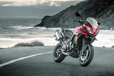 Tiger 1050 Sport available in red, white or black at a beach near you soon