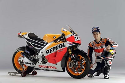 Dani Pedrosa with his new Repsol Honda. No wonder he looks so happy for once.