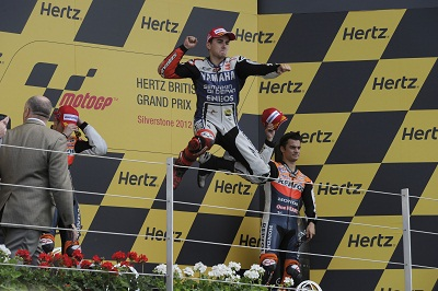 Jorge Lorenzo jumping fo rjoy at Silverstone last year, but will he be the same when he's sent back to the old pits and paddock?