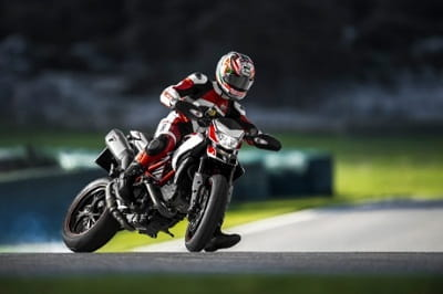A long career as a dirt track champion, ex MotoGP world champion and a new Ducati Hypermotard SP. Don't try this at home kids!