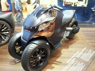Peugeot's Onyx. They make great scooters so this could be good. Not sure about the bronze paint though.