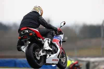 Don't laugh, even Ron Haslam couldn't get it leant over. The CBR's rear-end looks fantastic, with underseat exhaust and a neat LED rear light. Potter focuses on pulling in the next rider in the who dares to be brave in the wet competition.