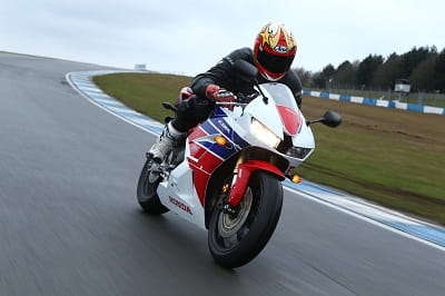 Honda's CBR600RR being tested at Donington's Craner Curve. It was slippery, but that gave us chance to test the new ABS system and forks.