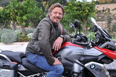 Charley Boorman. Adventurer, Dakar competitor, writer of blogs for Bike Social. He as in Deliverance as a boy too. Don't mention that when you're camping in the woods with him.
