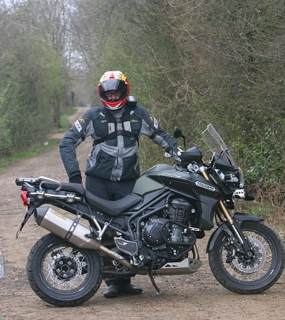 He looks proud. But he's been riding about on a new Triumph Tiger Explorer XC, so wouldn't you look excited like Potter?