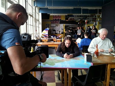 Ross Noble, a map, Twitter, and a man eating an egg wondering why he's being filmed.