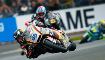 Bike Social's Scott Redding elbow down and leading Zarco at Le Mans